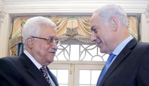 Mahmoud Abbas and Netanyahu smile at each other.